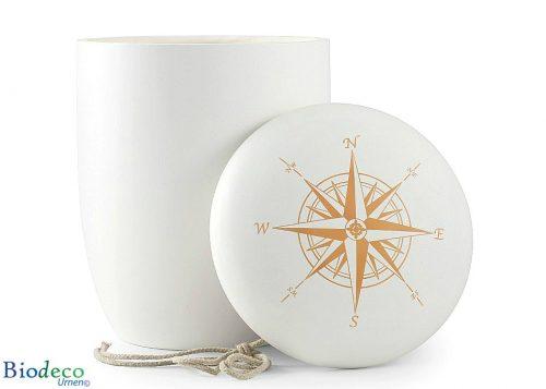 Biologisch afbreekbare zee-urn met een windroos op de deksel, met touw voor een asbijzetting